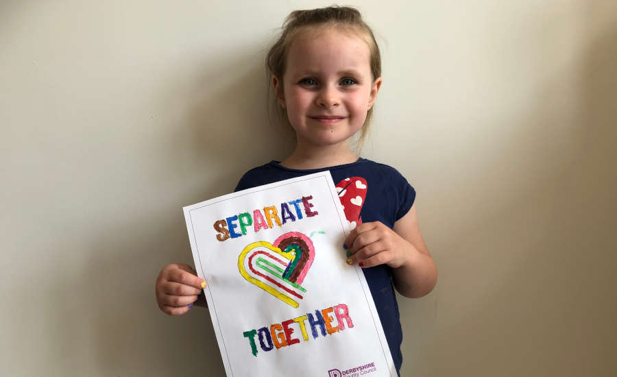 Evelyn from Alfreton holding separate together poster