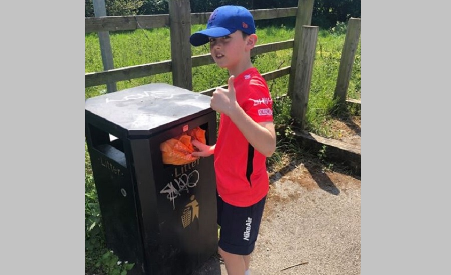Logan cleaning a country park
