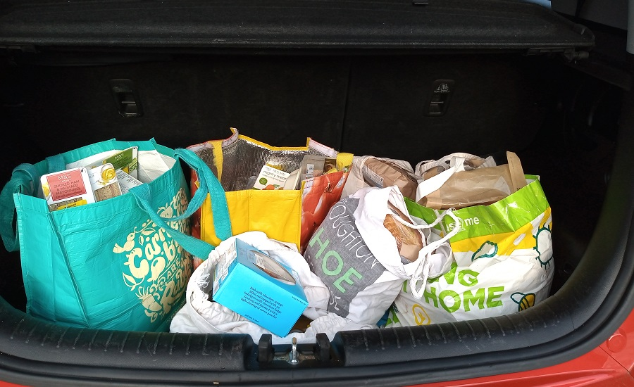 Shopping bags in car boot
