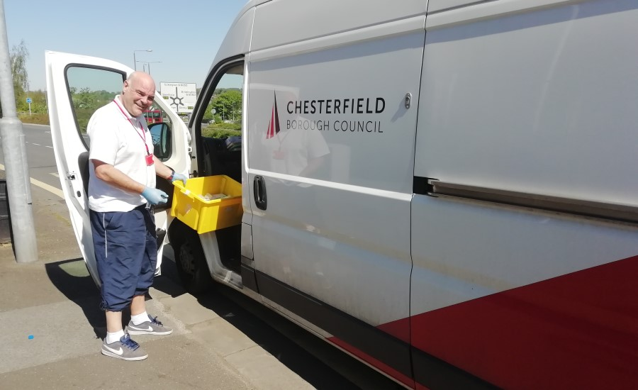 man putting a box in a Chesterfield Borough Council branded van
