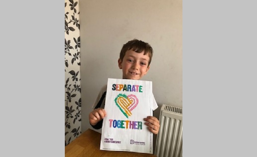 William holding a separate together poster